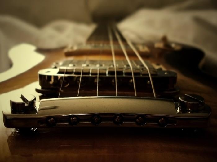 cropped-guitar-strings-pov-bridge1.jpg